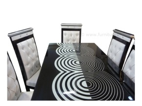 White and black designer dining table with lacquered glass. 6 artistic chairs. Highly irresistible and the one for you if you like designer products and want to make your relatives fill with awe on seeing it.